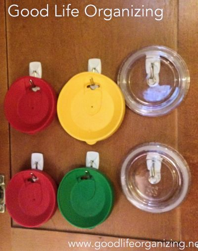 Use adhesive hooks to store lids to coffee and drink cups