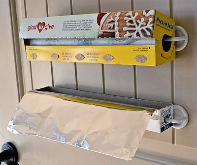 Use adhesive hooks to fold rolls of foil and plastic wrap